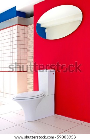 Modern bathroom detail with red wall and mirror reflection