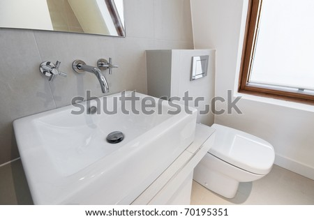 modern bathroom detail with roof window in a loft apartment - stock photo