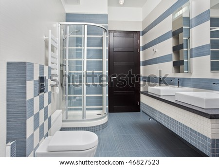 Modern bathroom in blue and gray tones with shower cubicle on wide angle view - stock photo