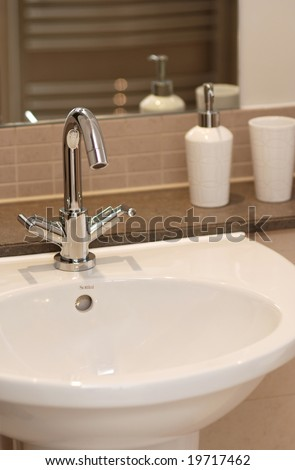 Modern bathroom in brown color - stock photo