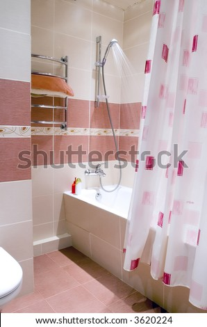 Modern bathroom in maroon and beige - stock photo