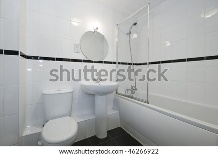 modern bathroom in white with floor to ceiling ceramic tiles
