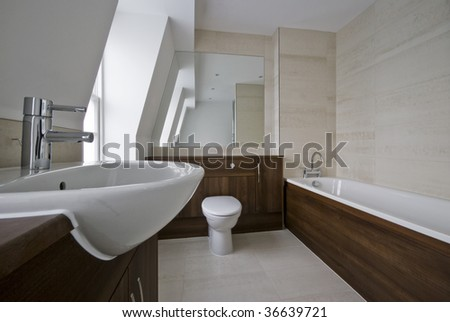 modern bathroom in white with wood elements and stone tiles