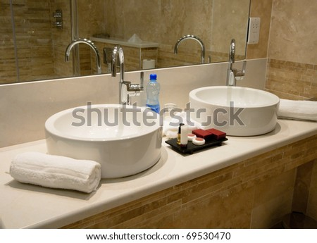 Modern Bathroom interior, marble sink and tap - stock photo