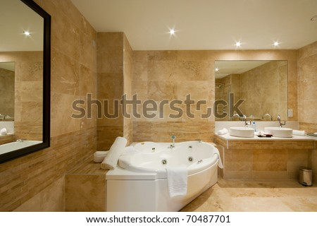 Modern Bathroom interior with marble tiles and mirror - stock photo