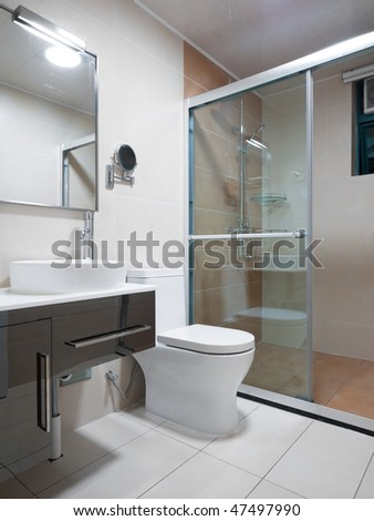 modern bathroom interior with mirror,sink and toilet