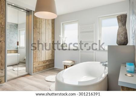 Modern bathroom interior with seperate bath - stock photo