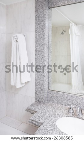 Modern bathroom part with mirror, towels, taps, shower and curtain - stock photo