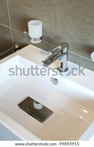 modern bathroom  sink in white ceramic - stock photo