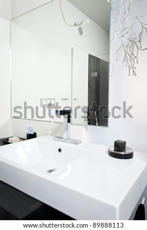 Modern bathroom white sink with flowing water - stock photo