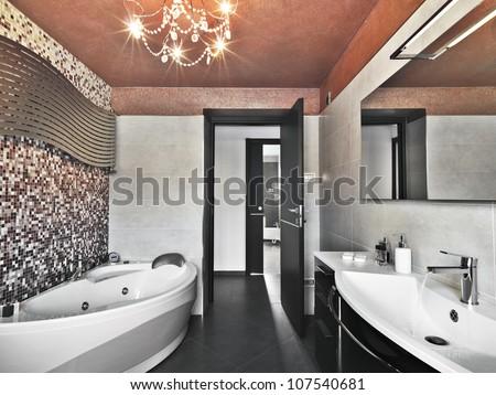 modern bathroom wit bathtub and washbasin - stock photo