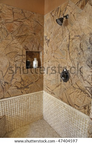 Modern bathroom with a luxurious marble tiled shower. - stock photo