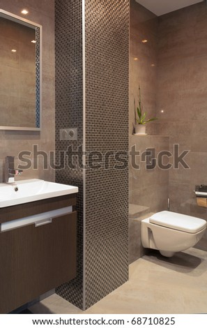 Modern bathroom with a mosaic column - stock photo
