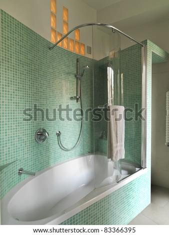 modern bathroom with bathtubs and shower masonry - stock photo