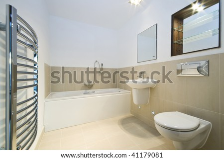 modern bathroom with beige tiled walls