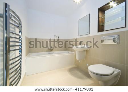 modern bathroom with beige tiled walls - stock photo