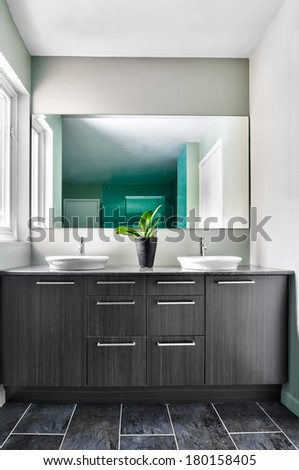 Modern Bathroom with big mirror. Soft Green Pastel Colors - stock photo