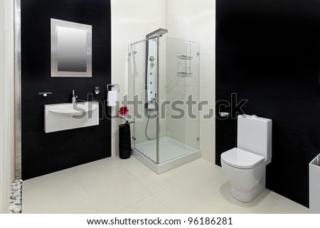 Modern bathroom with black and white tiles - stock photo