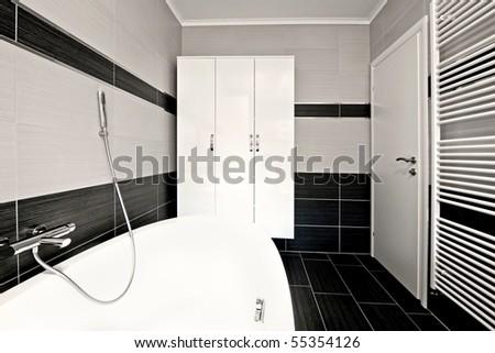 Modern bathroom with black tiles - stock photo