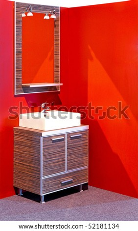 Modern bathroom with combination of ceramic and wooden vanities - stock photo