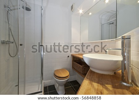 modern bathroom with designer suite and wood elements - stock photo