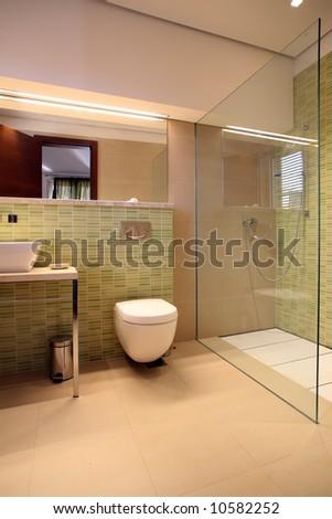 modern bathroom with glass wall - stock photo