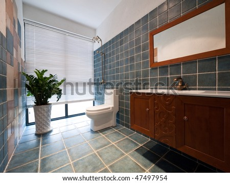modern bathroom with green plant,toilet and cabinet - stock photo
