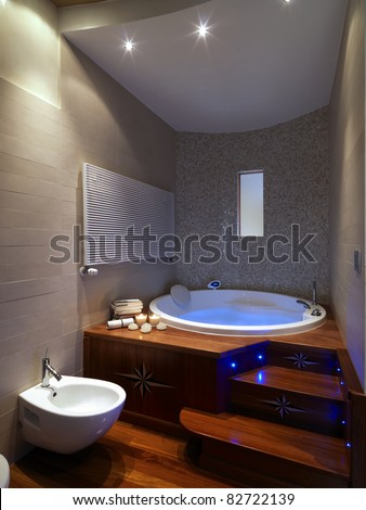 modern bathroom with large  bathtub with wood floor - stock photo