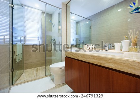 modern bathroom with mirror,cabinet,sink and toilet - stock photo