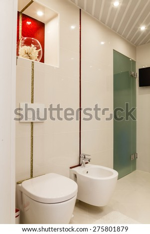 Modern bathroom with mirrors and cab. - stock photo