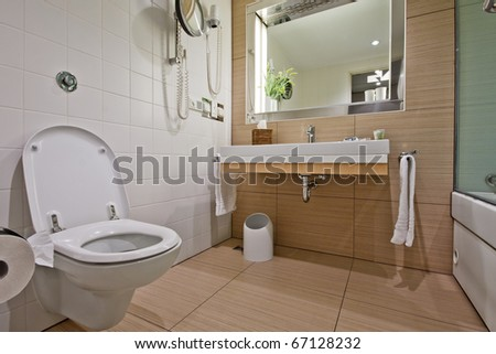 Modern bathroom with mirrors and  toilet sink - stock photo