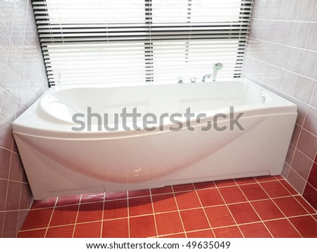 modern bathroom with porcelain bathtub