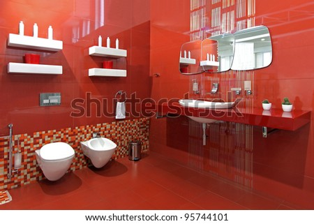 Modern bathroom with red ceramic walls and contemporary fixtures - stock photo
