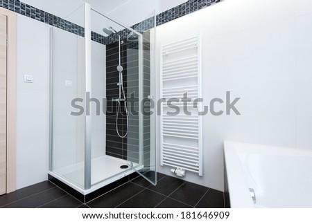modern bathroom with shower and bathtub - stock photo