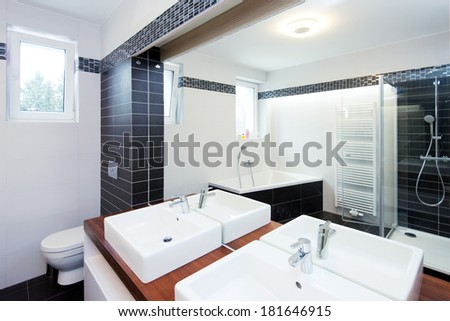 modern bathroom with shower and bathtub - stock photo