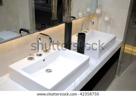 modern bathroom with sinks and mirror
