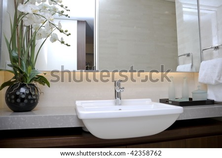 modern bathroom with sinks and mirror - stock photo