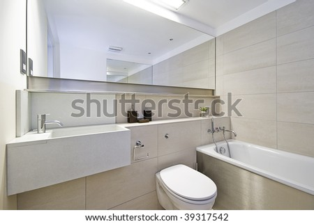 modern bathroom with stone tiles and shower corner - stock photo