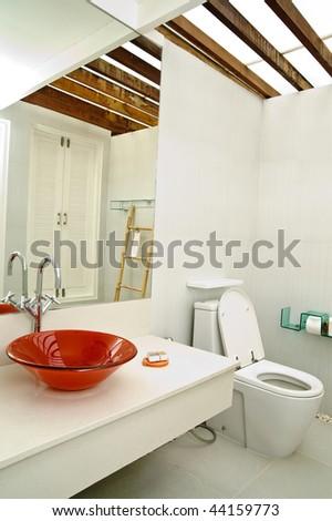 modern bathroom with tiled walls - stock photo