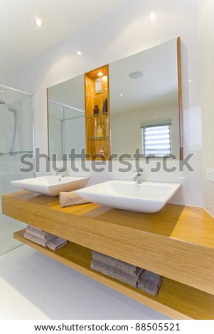 Modern Bathroom with Twin Sinks and Mirrors - stock photo