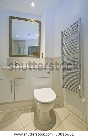modern bathroom with white ceramic appliances and shower cabin