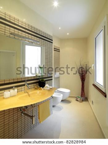 modern bathroom with yellow glass washbasin - stock photo