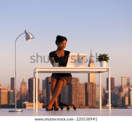 Modern beautiful African American Business woman in the city. New York Business series. - stock photo