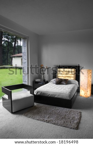 modern bed room designed interior, decorated in white tones - stock photo