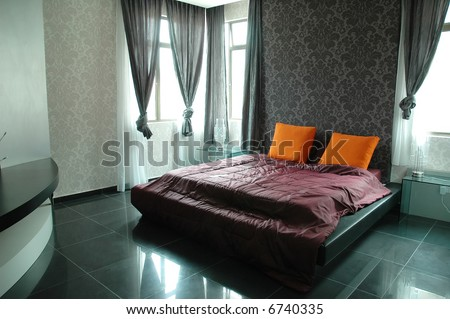 modern bed room interior design with black color as major color.