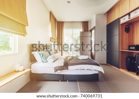 Modern bed room interior in Luxury villa. Big window