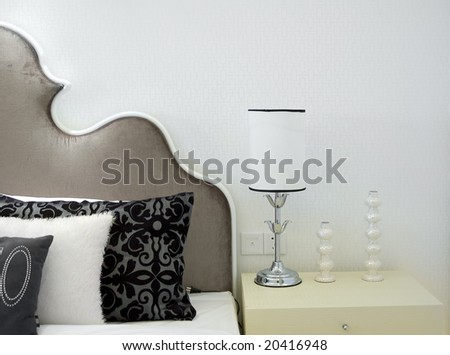 Modern bed room interior -- Lamp and pillows - stock photo