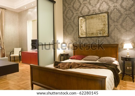 modern bedroom and a part of living room - stock photo