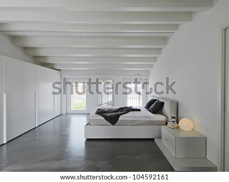 modern bedroom in a attic - stock photo