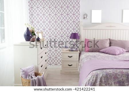 modern bedroom interior and purple decor - stock photo